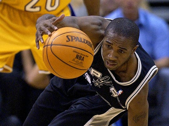 San Antonio Spurs' Speedy Claxton loses the ball as Los Angeles Lakers' Brian Shaw (20) watches during the second quarter of Game 3 of the Western Conference semifinal series Friday May 9 2003 in Los Angeles.