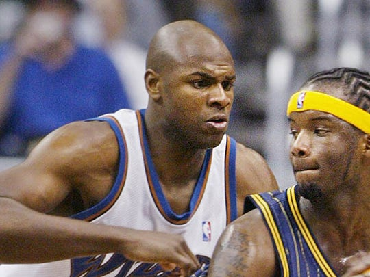 Indiana Pacers' Jermaine O'Neal (7) is guarded by Washington Wizards' Brendan Haywood during the first half Friday Feb. 20 2004 in Washington.
