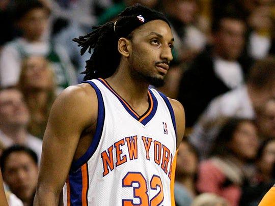 New York Knicks'  Renaldo Balkman (32) leans against a table during a break in the third quarter of an NBA basketball game against the Boston Celtics in Boston on Thursday,