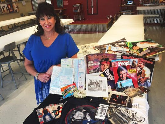 Bruce Springsteen fan Tammy Milam, owner of Painting With a Twist, in Lafayette, has a huge collection of Springsteen memorabilia, much of which is from Asbury Park, New Jersey.