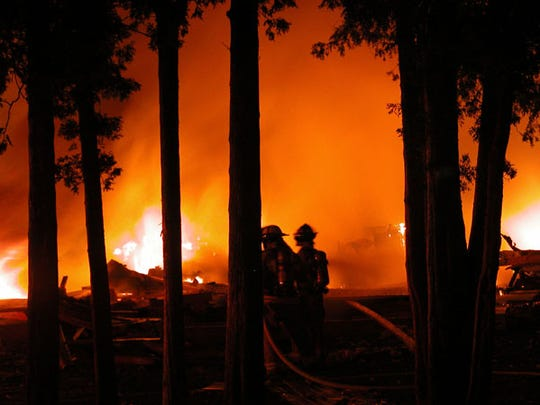 Fire raged at several locations after a propane explosion rocked five buildings in Ellison Bay early in the morning of July 10, 2006.