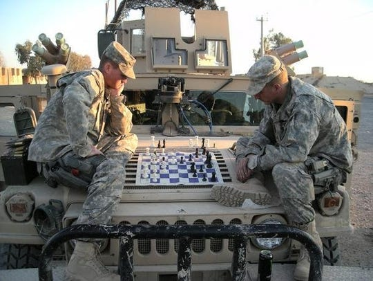 Bucyrus native Major Thomas Herman plays a little chess