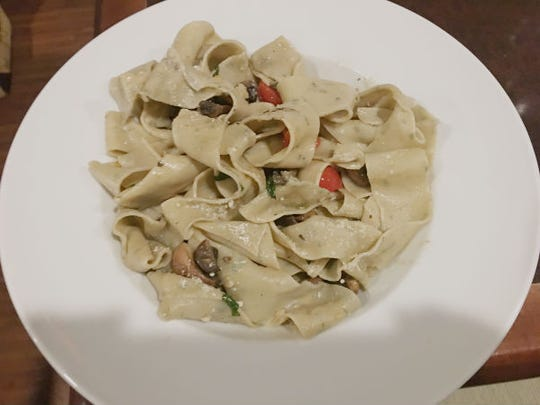 Tack and Jibe's  herb ribbon pasta with wild mushrooms and cherry tomatoes.