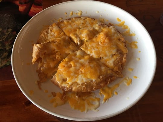 Cindo de Mayo's cheese crispy appetizer is like a king-size nacho cut like a pie. It has a very thin and delicately flaky shell like a tostada.