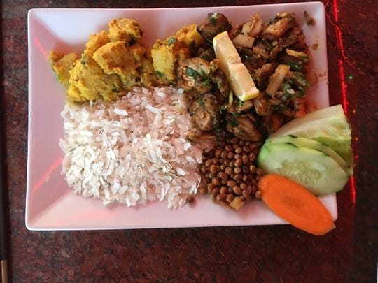 """Namaste Grill's chicken chhoila is chicken thigh meat grilled and marinated with ginger, garlic, enriched green onion, tomato and cilantro. This was served as a Nepali """"kahja set""""  with the accompaniments of crispy soy peas, chiuraa and potatoes."""