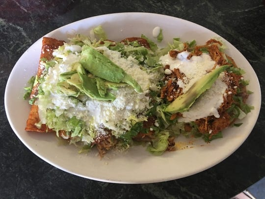 Adelina's Restaurant & Bakery's enchiladas and sopes tinga.
