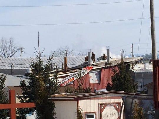 Firefighters battle a blaze at Godshall's Quality Meats