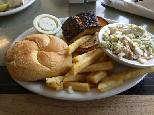 Long Point Cafe's blackened Mahi sandwich is served with french fries and cole slaw.