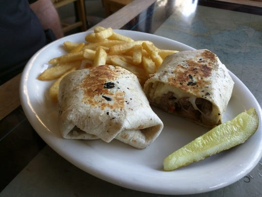 Long Point Cafe's grilled marinated sirloin tip steak in a garlic herb tortilla.