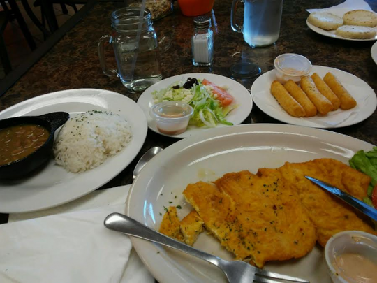 El Moralito's pollo empanizado is a huge chicken breast pounded thin, lightly tossed in breading and fried.