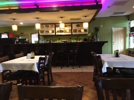 The inside view of Oh Toi Asian Restaurant, which is is tucked away in the corner of a strip plaza on Port St. Lucie Boulevard.