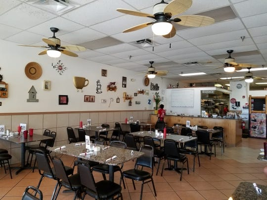 The interior of Zachary's Cafe is surprisingly spacious, clean and tastefully decorated.