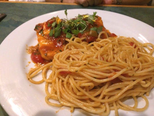 Vincent's salmon in a tomato sauce served with spaghetti.