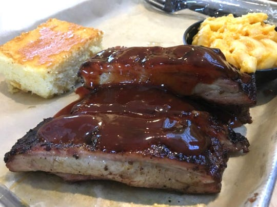 Tillman's quarter rack of ribs are four St. Louis-style spareribs that pulled free easily from the bone. They can be smothered in barbecue sauce at your request but the seasoned rub alone is amazing. Meals come with a side (pictured is mac and cheese) and cornbread.