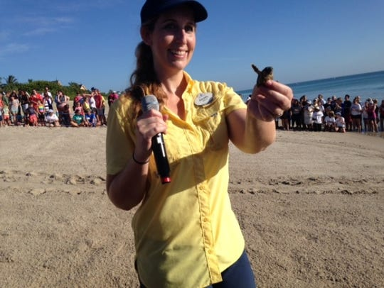 Disney biologist Rachel Smith shows off one of the