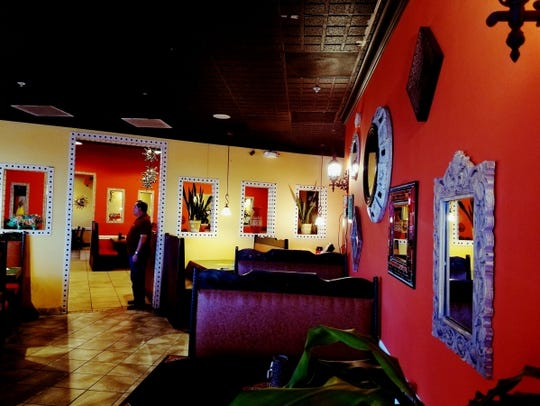 The interior of Mayas Grill is vibrantly decorated,