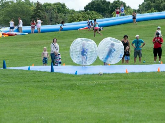 The Splashkosh party festival included many type of games, live music, and a 200-foot slip-and-slide held at Red Arrow park on Saturday, August 5, 2017.