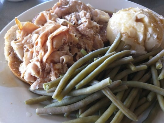 Hen House Eatery's open-faced turkey sandwich with mashed potatoes and green beans.