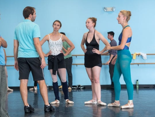 Adam Schnell works with dancers who will perform in