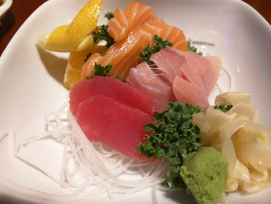 Raw fish, without the rice, is sashimi. Here is sashimi