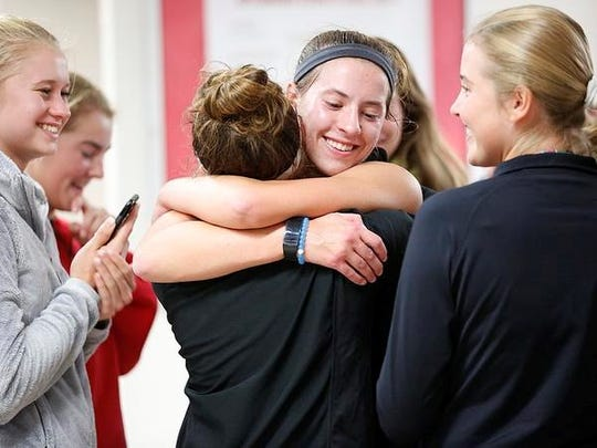 Neenah's Kiki Risgaard gets congratulations from teammates