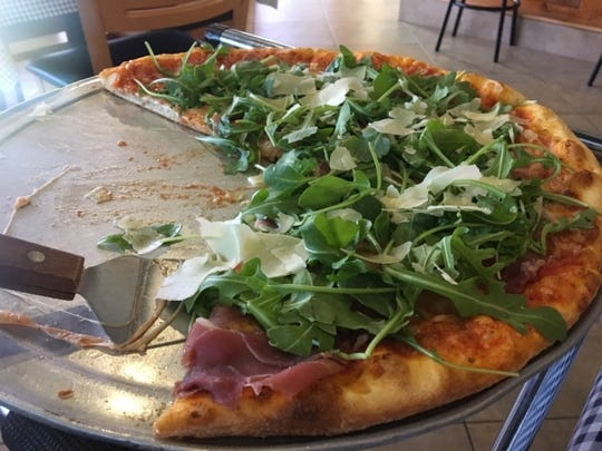 Gio-Joe's Pizzeria's primavera pizza is a basic mozzarella-and-marinara-coated pie topped with fresh arugula, giving it a nice peppery bite, a subtle saltiness from the prosciutto and finished off with shaved Parmesan cheese.