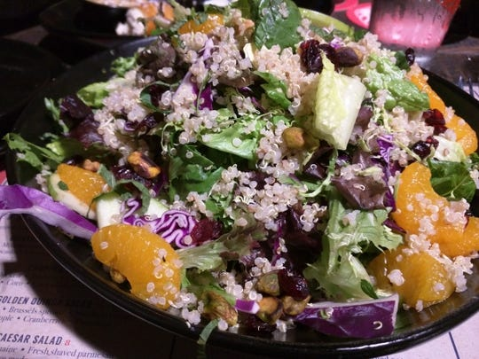 American Icon Brewery's large quinoa salad was mixed greens, Brussels sprouts, Mandarin oranges, apples, cranberries and pistachios. The salad dressing was a lemon herb viniagrette.