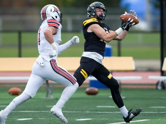 UW-Oshkosh's Sam Mentkowski makes a catch during a game against UW-River Falls earlier this season at Titan Stadium.