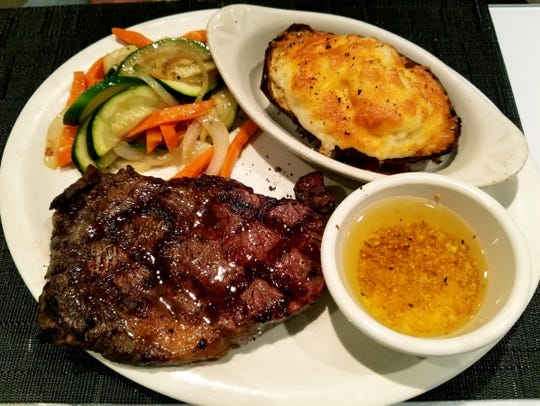 1120 Prime's ribeye with veggies and a twice baked