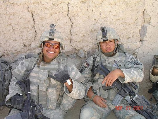 Travis Craig (left) while deployed in Ghazni, Afghanistan.