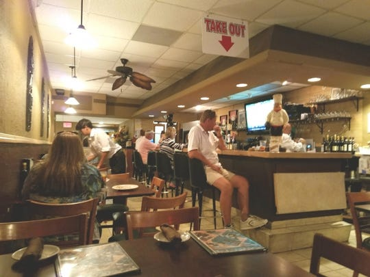 Amato's dining room is small, with tables and counter