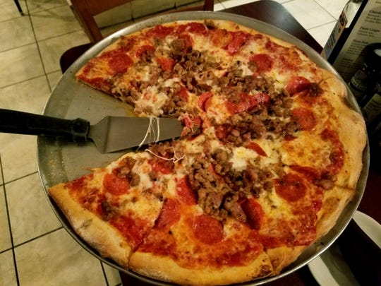 Amato's sausage and pepperoni pizza. All pizzas are 16 inches.