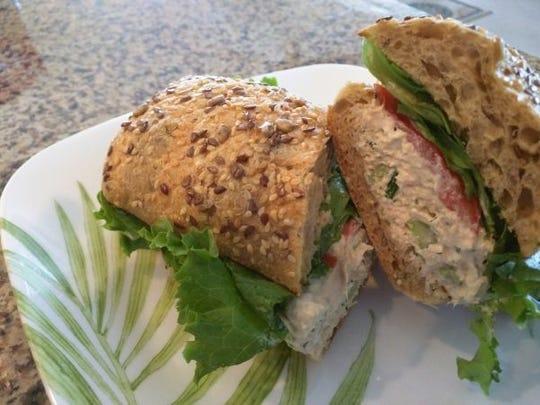 Zesty tuna salad is sandwiched between a fresh, multi-grain