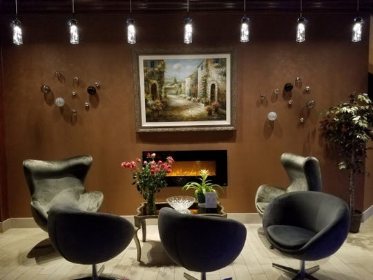 La Forchetta's is chic, modern, and sophisticated. It has a sitting area complete with a fireplace.