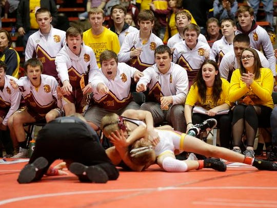 Luxemburg/Casco High School Wrestlers watch as  Issac Blohowiak competes against Carter Huppert of Ellsworth High School Saturday, March 3, 2018, in the 113 pound weight class of the WIAA division 2 state championship match in Madison, Wisconsin. Blohowiak won by major decision 14-6 and Luxemburg/Casco won the match 30-28.