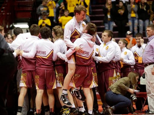 Luxemburg-Casco wrestlers celebrate after winning the championship against Ellsworth in the WIAA Division 2 state championship match Saturday in Madison.
