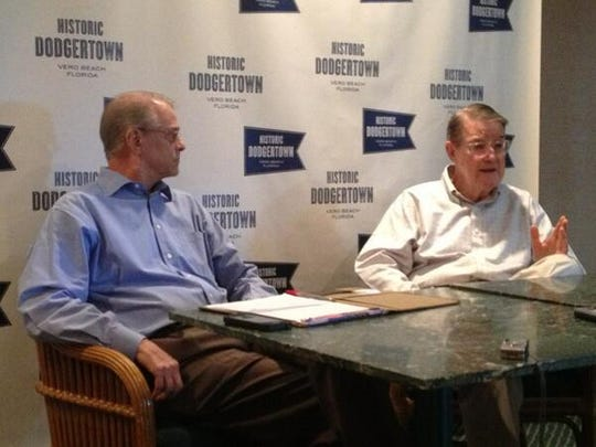 Peter O'Malley (right) former owner of the Los Angeles Dodgers, and Craig Callan speak with reporters in 2013  while announcing the changing of the name of Vero Beach Sports Village to Historic Dodgertown.