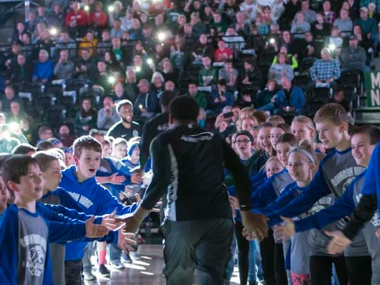 Oshkosh West youth basketball club players cheer on the Wisconsin Herd during introductions March 21 at Menominee Nation Arena in Oshkosh.