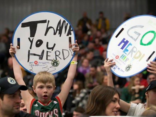 "Lukas Dean holds up a sign saying ""Thank you Herd"" during the last game of the G-League season March 23 at Menominee Nation Arena in Oshkosh."