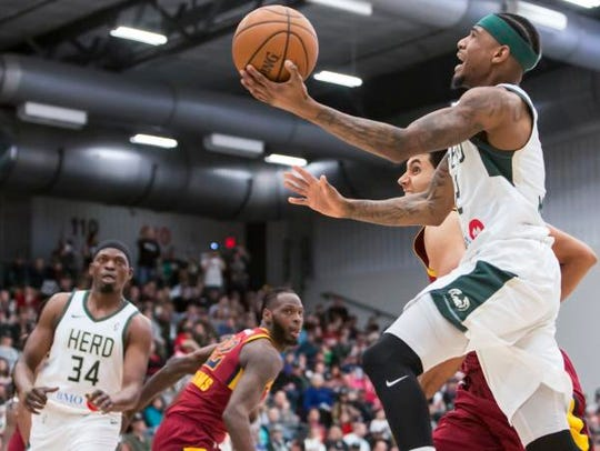 Xavier Munford of the Wisconsin Herd shoots takes the ball to the basket during a March game at Menominee Nation Arena in Oshkosh.