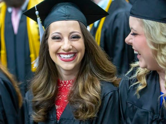 Serena Larie graduates from the University of Wisconsin-Oshkosh during a ceremony last May at the Kolf Sports Center.