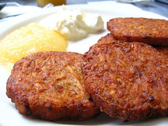 Potato Latkas with applesauce from Maccabee's Kosher Deli.