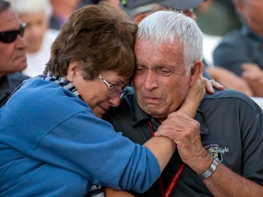 Veteran Dennis Bradley is consoled in an emotional welcome home celebration of an Old Glory Honor Flight during Friday's AirVenture on the EAA grounds July 27, 2018.