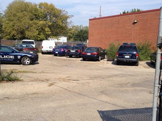 These Lincoln Heights police vehicles sat untouched in the parking lot Thursday.
