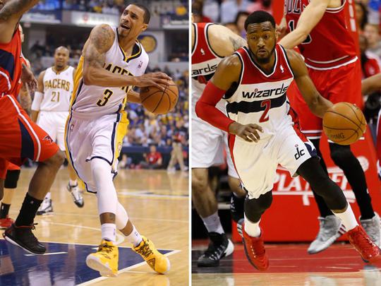 George Hill (left) and John Wall (right).