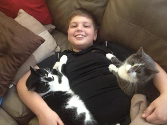 Tom (right) was recently hit by a car and killed. He is shown here with reporter Dana Benbow's son, Davis, and his brother, Domino.