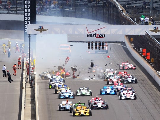 Crash at the start of the inaugural Grand Prix of Indianapolis.