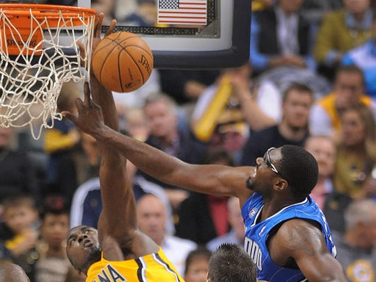 Pacers Roy Hibbert blocks the shot by Orlando's Jason Maxwell. Indiana Pacers play the Orlando Magic in their season opening game Tuesday, October 29, 2013, evening at Bankers Life Fieldhouse. Matt Kryger / The Star