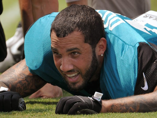 Trainers look at wide receiver Tandon Doss as he lies on the field with an injury during a NFL football training camp Thursday, July 31, 2014 in Jacksonville, Fla. (AP Photo/The Florida Times-Union, Will Dickey)