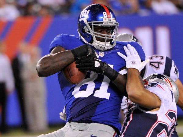 New York Giants tight end Adrien Robinson (81) is tackled by New England Patriots' Sterling Moore (29) during the second half of a preseason NFL football game Wednesday, Aug. 29, 2012, in East Rutherford, N.J. (AP Photo/Bill Kostroun)